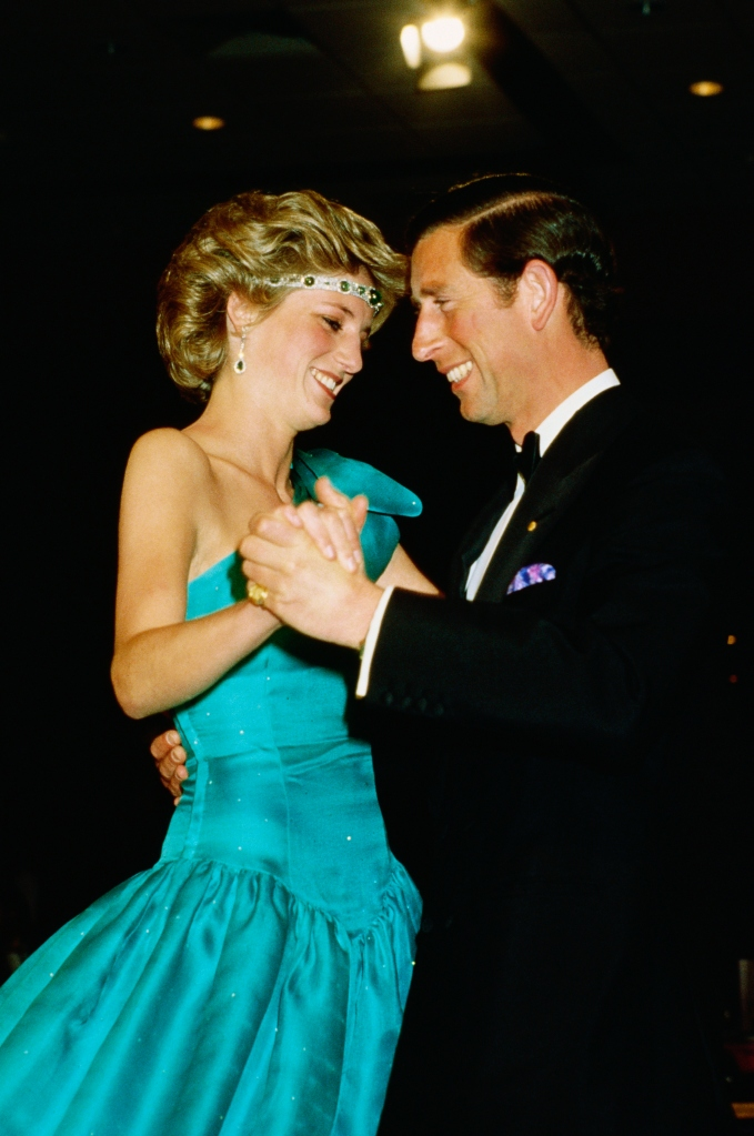 Princess Diana wearing an emerald chocker as a headband while dancing with Prince Charles