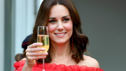 Kate Middleton holding glass of champagne
