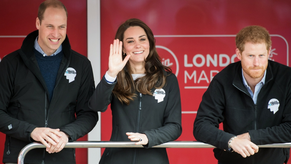 Prince William, Kate Middleton, and Prince Harry at an event