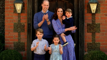Prince William, Kate, and kids clapping outside Kensington Palace