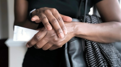 Close-up of woman's hands as she applies lotion