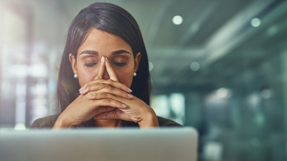 Woman stressed at desk