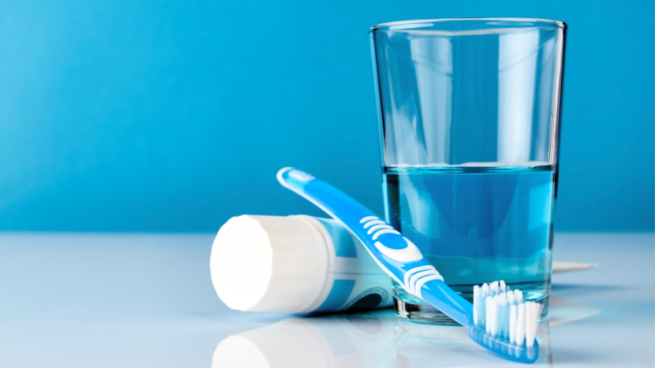 Toothpaste, toothbrush, and glass of mouthwash
