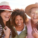 three mature female friends smiling