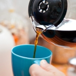 Woman's hands pouring coffee