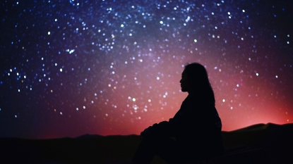 woman looking for christmas star in the sky