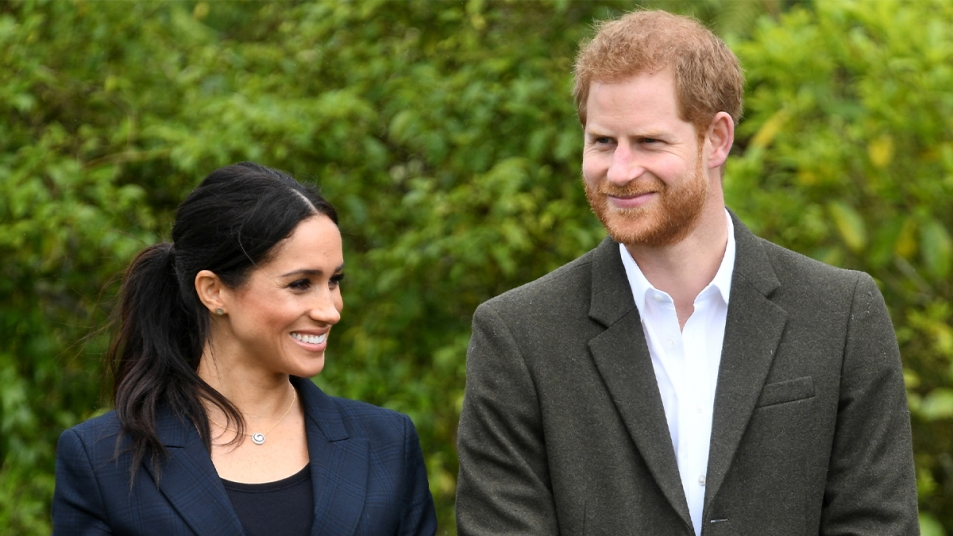 Harry and Meghan both smiling