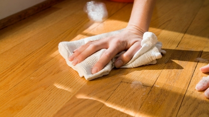 Person Cleaning Hardwood Floor