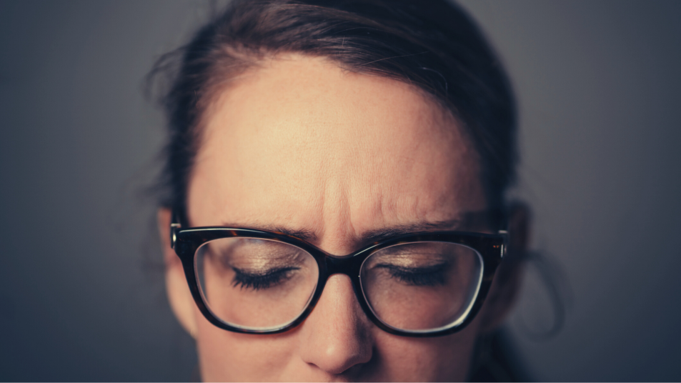 woman wearing glasses and closing her eyes