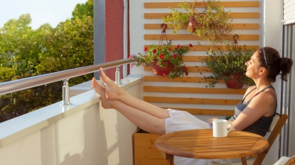 Woman relaxing on her balcony