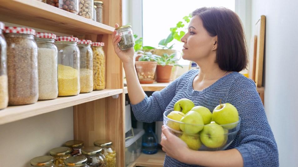 Woman organizing her pantry