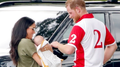 Prince Harry with Meghan Markle holding Archie