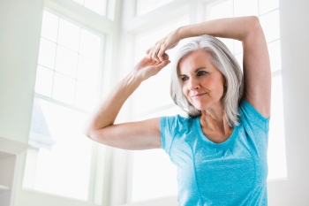 older woman stretching