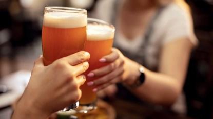 Women's hands holding beer