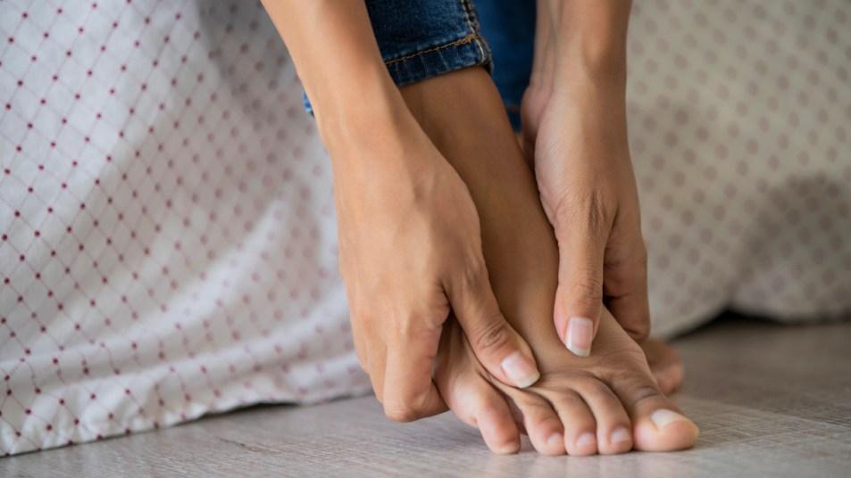 Woman's hands massaging her foot