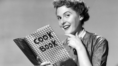 1950s woman with a cookbook