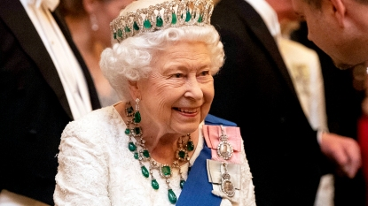 Queen Elizabeth wearing emerald and diamond tiara, earrings, and necklace