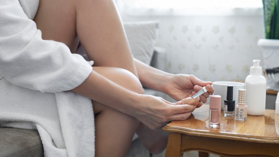 Woman doing a pedicure at home