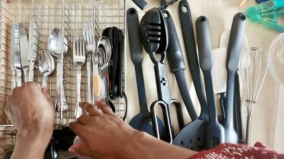 Woman organizing a silverware drawer