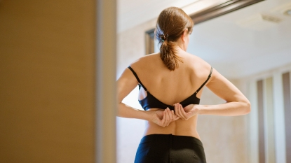 Woman putting on a bra