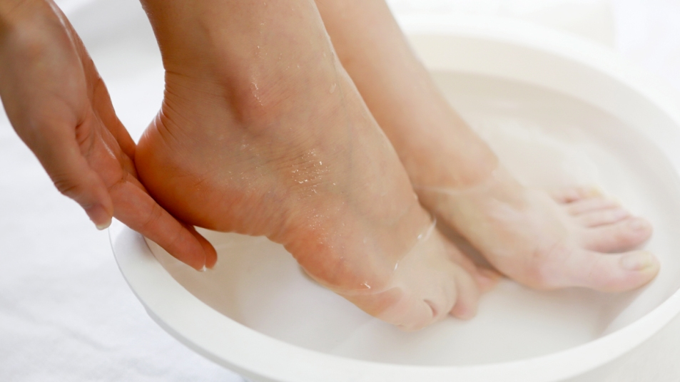 Woman's feet soaking in water