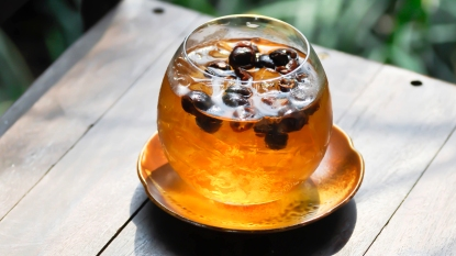 Clear glass of iced cascara