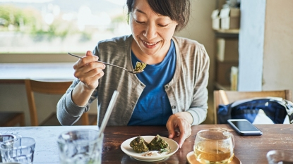 Woman eating breakfast
