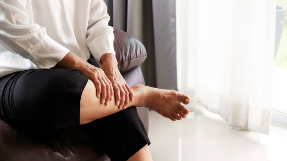 Woman holding her leg