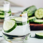 Glasses of water with cucumber slices
