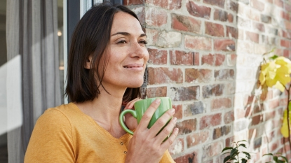 Smiling woman with cup of tea