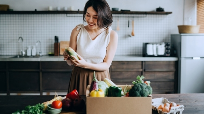 Woman Receiving Her Grocery Delivery story image