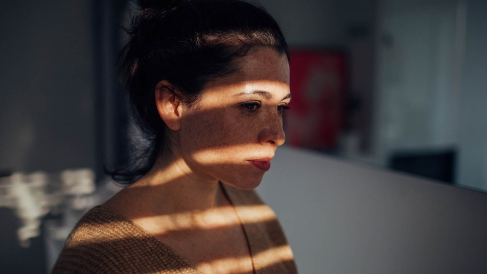woman with her face in shadow