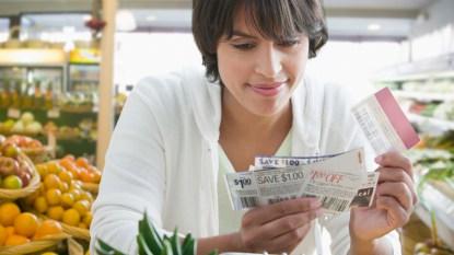 Woman looking at coupons