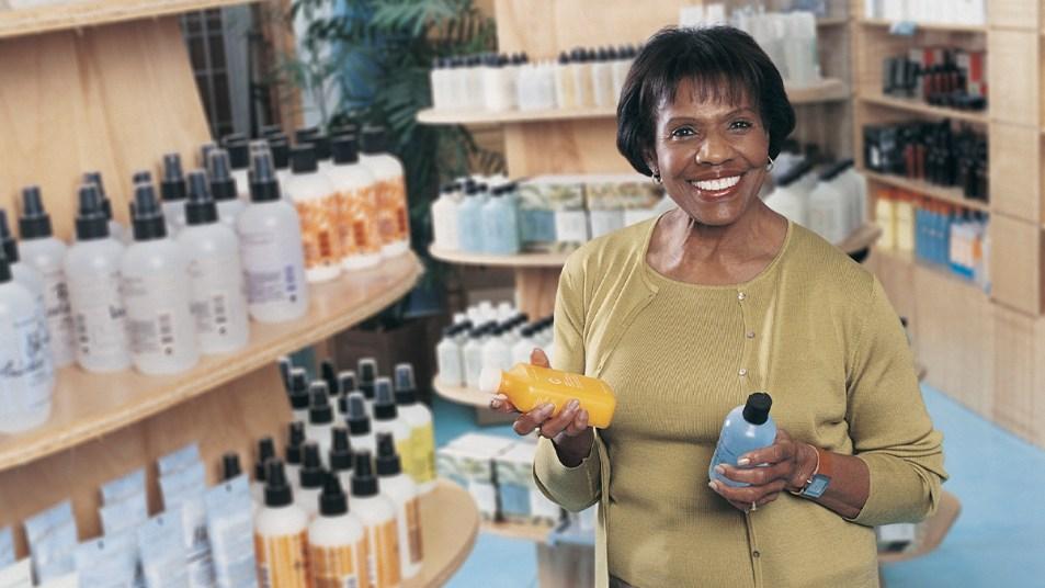 Woman shopping for shampoo