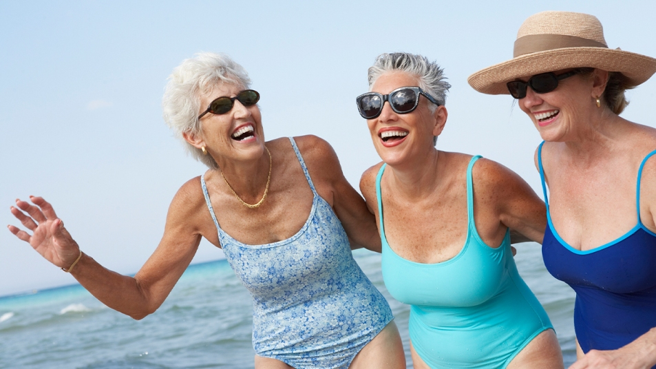 A group of women having fun at the beach
