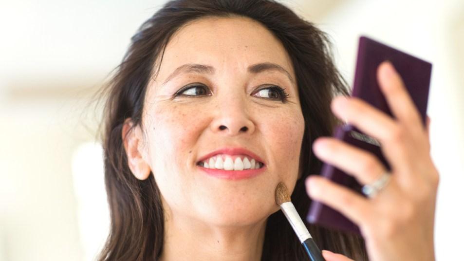 Woman doing her makeup