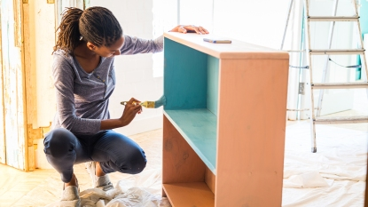 Woman doing a home DIY project