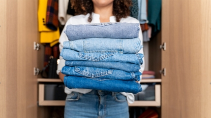 Woman holding jeans