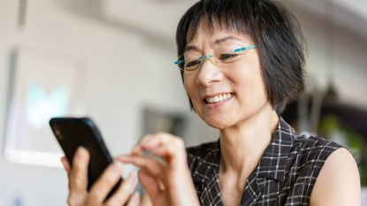 Woman with glasses on her phone
