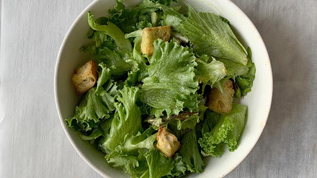 Salad with avocado salad dressing