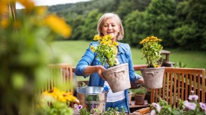 Woman holding flower pots