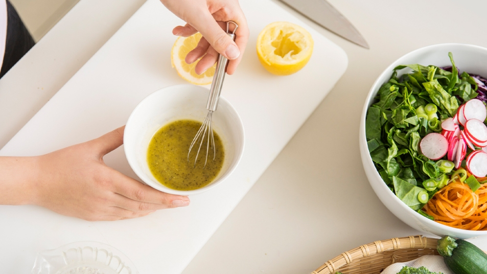 Woman mixing a salad dressing